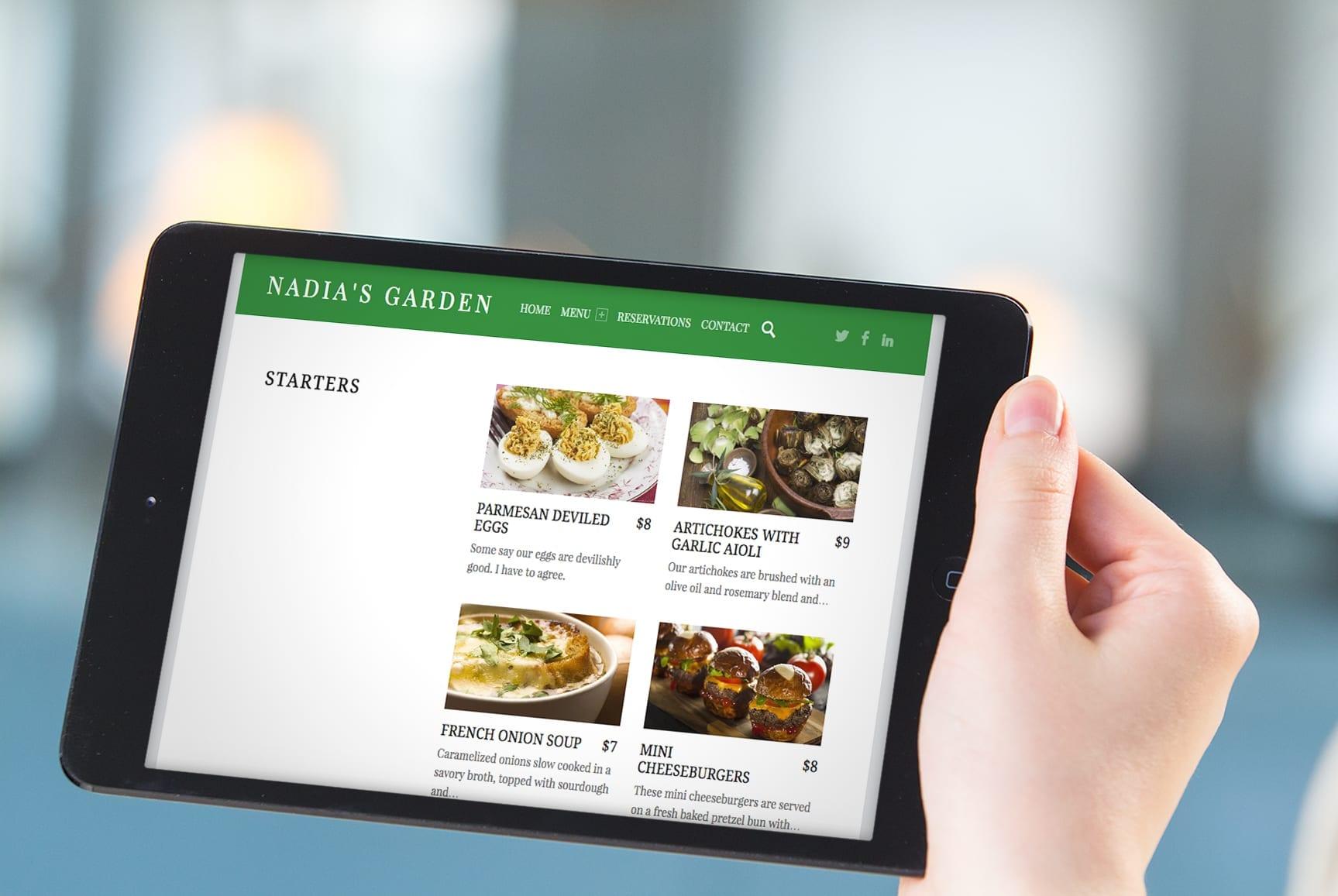 Tablet com layout do site do restaurante Nadia's Garden